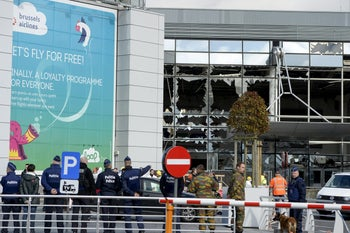 Windows blown out by the bombings at a Zaventem Airport terminal, Brussels, Wednesday, March 23, 2016.