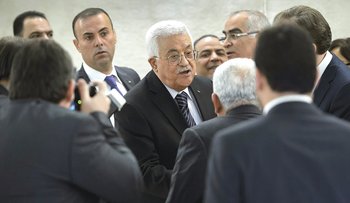 Palestinian president Mahmud Abbas (C) receives messages from delegates after addressing the UN Human Rights Council on October 28, 2015