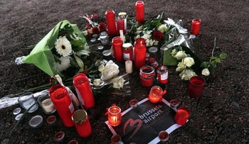 Flowers and candles laid on the ground near Brussels airport in Zaventem, March 24, 2016.
