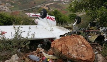 The wreckage of Mounir Amar's plane near Rameh in the Galilee on Friday.