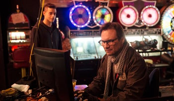 This photo provided by USA Networks shows, Rami Malek, left, as Elliot, and Christian Slater as Mr. Robot in a scene from the pilot episode of the television series, 'Mr. Robot.'
