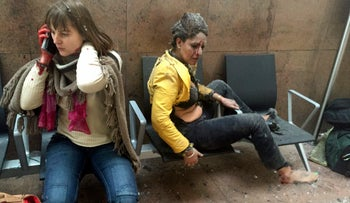 In this photo provided by Georgian Public Broadcaster, injured women are seen in Brussels Airport in Brussels, Belgium, after explosions were heard Tuesday, March 22, 2016.