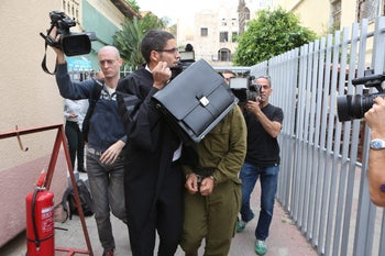 The soldier and his lawyer entering a military court in Jaffa, March 25, 2016.