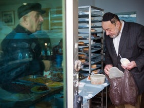 A Jewish man collects food from a soup kitchen, Jerusalem, Israel, January 13, 2010.