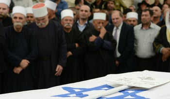 Mourners attend the funeral of Civil Administration chief Brig. Gen. Mounir Amar in northern Israel on Sunday, March 27, 2016.