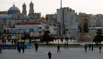 People walking in Taksim Square, near the site of Saturday's terror attack in Istanbul, March 20, 2016.
