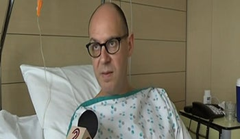 Walter Benjamin speaking to Israel's Channel 2 News from his hospital bed in Brussels, March 28, 2016. (Screenshot from Israel's Channel 2).