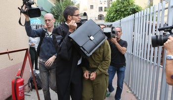 The IDF soldier who shot the wounded Palestinian terrorist in Hebron being escorted to court on the day after the incident, on March 25, 2016.