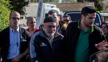 Ezra Nawi, a member of the Israeli-Palestinian political group Ta'ayush, being taken to a Jerusalem court in January, 2016.