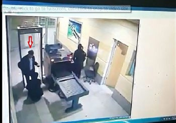 A handout picture provided by the Egyptian ministry of interior shows a screen grab of CCTV footage reportedly showing the hijacker of the EgyptAir flight diverted to Cyprus, going through airport security checks at Egypt's Alexandria airport on March 29, 2016.