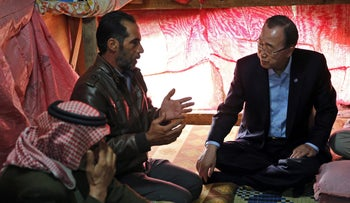 UN chief Ban Ki-moon speaks with Syrians inside their tent during a visit to an informal refugee settlement, Dalhamyeh, Bekaa valley, Lebanon, March 25, 2016.