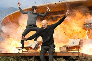 This image released by Sony Pictures shows Sacha Baron Cohen, left, and Mark Strong in Columbia Pictures' 'The Brothers Grimsby.'