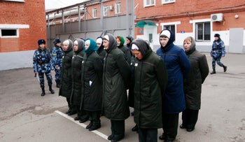 Inmates stand in line before reporting for work inside female prison camp Number 22 in Russia's Siberian city of Krasnoyarsk, November 21, 2013.
