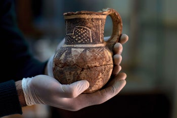 Jihad Abu Kahrlah, an archeologist at Syria's National Museum, holds an artifact delivered from the Daraa Museum to Damascus, Syria, February 23, 2016.