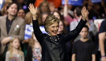 Democratic presidential candidate Hillary Clinton reacts at the Apollo Theater in New York, March 30, 2016.