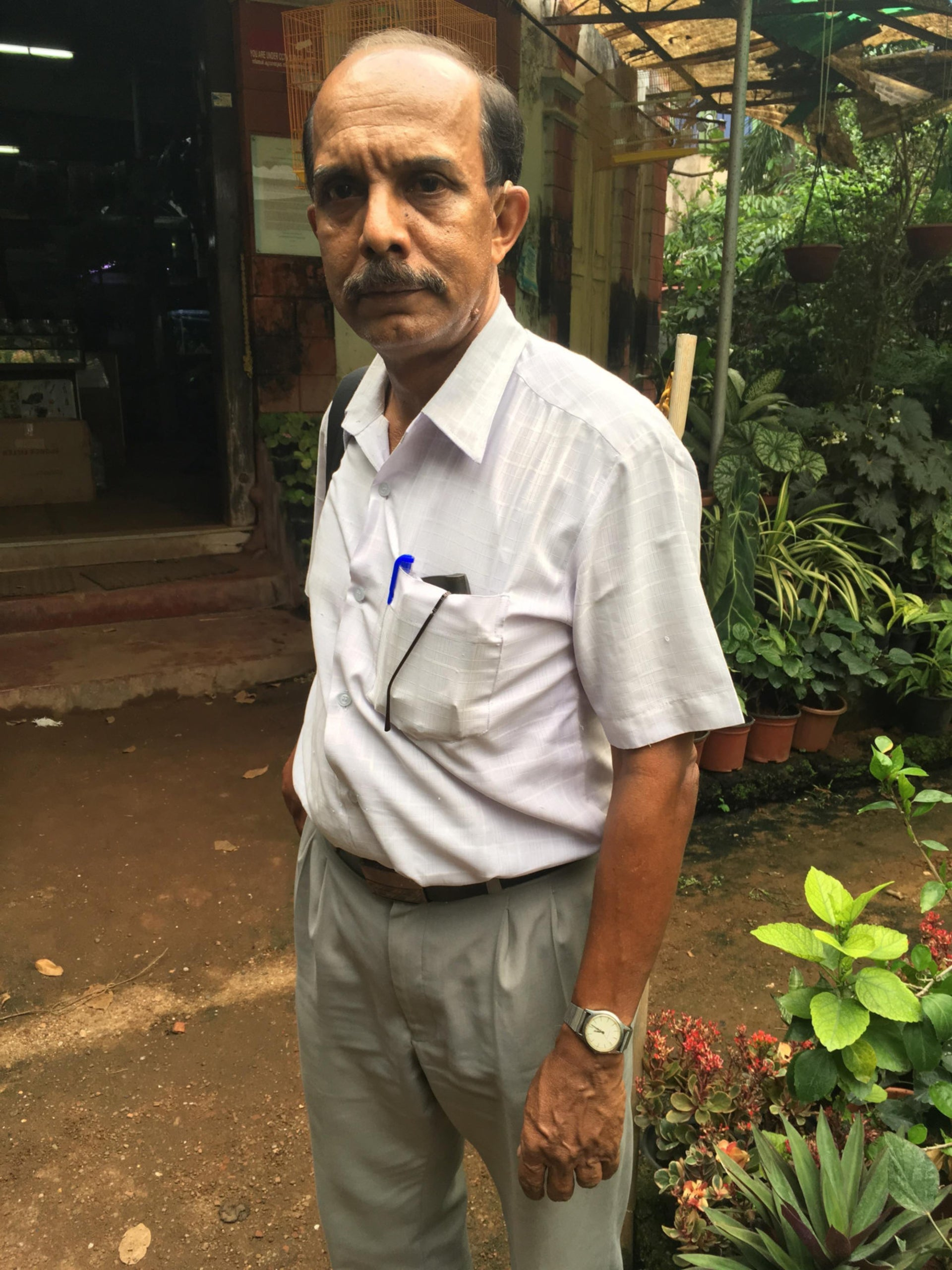 Prof. C. Karmachandran, a retired history and government teacher who is working to preserve a Jewish cemetery.