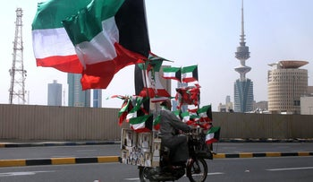 A man drives his motorcycle decorated with Kuwaiti flags on a highway in Kuwait City on February 25, 2015