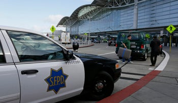 A police car is parked on the arrivals level outside the international terminal of San Francisco International Airport on Tuesday, March 22, 2016.