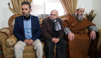 From left to right, the father, uncle and grandfather of Abed Fattah al-Sharif, the Palestinian shot and killed by Azaria.