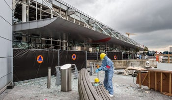 In this March 23, 2016 file photo, a forensics officer works in front of the damaged airport terminal in Brussels.