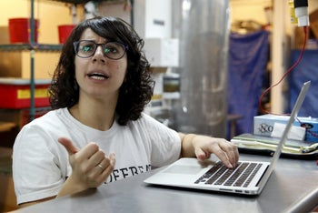 Manal Kahi, co-founder of Eat Offbeat, a New York food company where refugees make and deliver ethnic fare, speaks at their kitchen area in the Queens borough of New York February 25, 2016.