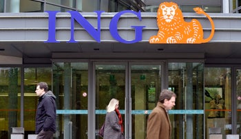 Pedestrians pass by the ING Bank in Brussels, Belgium, November 9, 2009.