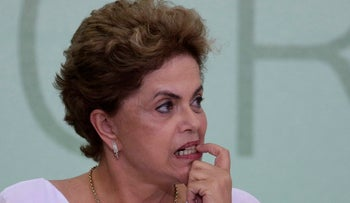 Brazil's President Dilma Rousseff bites on her fingernail during a ceremony at the Planalto Presidential Palace, April 1, 2016.
