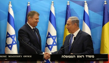 Israeli Prime Minister Benjamin Netanyahu and Romanian President Klaus Werner Iohannis shake hands during a press conference in Jerusalem, March 7, 2016.