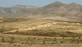 Armenian and Karabakh armed forces hold joint military exercises at a training ground near the town of Tigranakert in the unrecognized Republic of Karabakh, November 14, 2014.