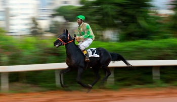 A jockey rides a horse during a race at the Beirut horse racetrack in Beirut, Lebanon, Thursday, March 24, 2016.