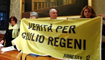"""(From Left to Right) Paola Regeni, Senator Luigi Manconi, Claudio Regeni and lawyer Alessandra Ballerini hold a banner reading """"Truth for Giulio Regeni"""", the Italian student murdered in Egypt, during a news conference at the upper house of the parliament in Rome, Italy, March 29, 2016."""