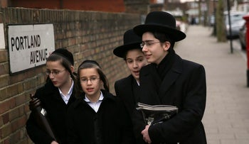 Young ultra-Orthodox men heading to synagogue in north London, Britain, on Purim in March 2016.