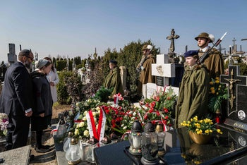 Children and granddaughters of Jewish survivor Abraham Segal pay respect during a ceremony at the grave of The Ulma family, Polish family who sacrificed itself as they were hiding Jews during Holocaust and WWII, on March 17, 2014 in Markowa.