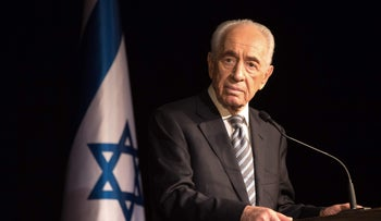 President Shimon Peres adressing members of the Foreign Press Association during a visit in Sderot, Israel, July 06, 2014.