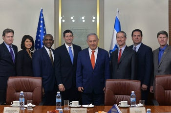 Israeli Prime Minister Benjamin Netanyahu, center, meeting with a U.S. congressional delegation led by House Speaker Paul Ryan, fourth from left, April 4, 2016.