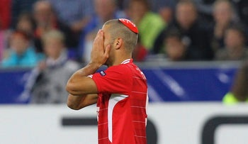Hapoel Tel Aviv's Itay Shechter celebrates by putting on a kipa after scoring a goal against Red Bull Salzburg during their Champions League qualifying soccer match in Salzburg August 18, 2010.