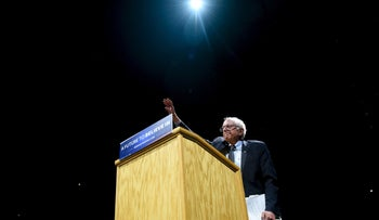 Democratic U.S. presidential candidate Bernie Sanders waves to the crowd at a campaign rally in Madison, Wisconsin April 3, 2016.