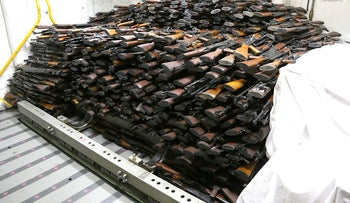 Photo released by the U.S. Navy showing alleged cache of Iranian weapons likely intended for Yemen Houthi rebels.