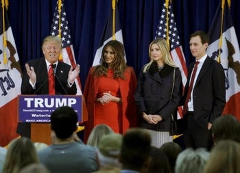 U.S. Republican presidential candidate Donald Trump speaks as (L-R) his wife Melania, daughter Ivanka and Ivanka's husband Jared Kushner listen, at a campaign rally on caucus day in Waterloo, Iowa February 1, 2016.
