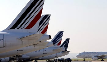 Air France planes are parked on the tarmac of the Paris Charles de Gaulle airport, September 15, 2014.