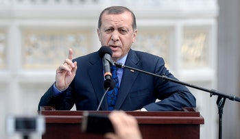 Turkey's President Recep Tayyip Erdogan speaks as he inaugurates the Diyanet Islamic Cultural Center in Lanham, Maryland on April 2, 2016.
