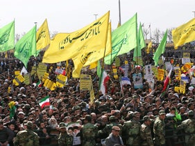 Iranians holding banners in support of Supreme leader Ayatollah Ali Khamenei and Islamic Republic's aims during a rally commemorating 37th anniversary of the Islamic in Tehran, on February 11, 2016.