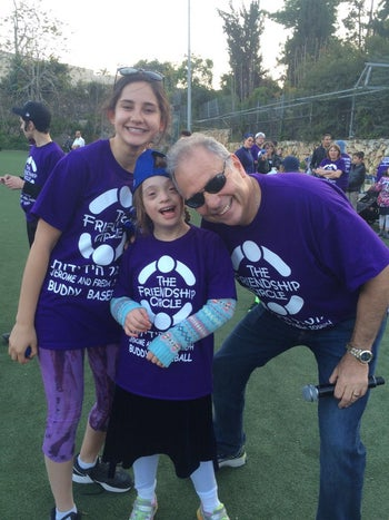 Dean Klassman and children participating in the Buddy Baseball game on Thursday.