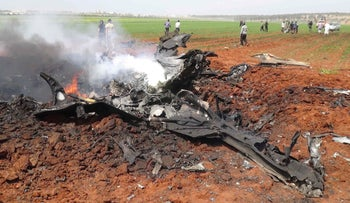 The wreckage of a government warplane after Nusra Front reportedly shot it down over the northern Syrian town of Al-Eis on April 5, 2016.