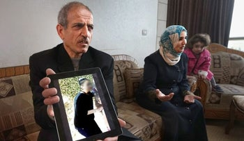 The parents of the imprisoned 12-year-old girl with her picture.