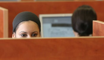An ultra-Orthodox woman working in the open-plan office of a high-tech company.
