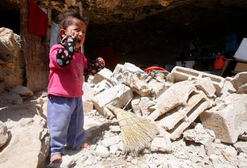 A Palestinian girl cries as she stands outside a cave that she lived in with her family after Israeli forces destroyed its entrance in Khirbet Tana, near the West Bank city of Nablus April 7, 2016.