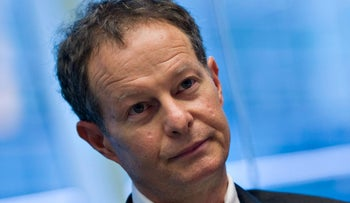 John Mackey, CEO of Whole Foods Market Inc., listens during an interview in New York, U.S., on Monday, Nov. 16, 2009.
