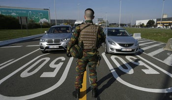 A soldier controls vehicles arriving at Brussels' airport following last month's deadly bombing, April 11, 2016.