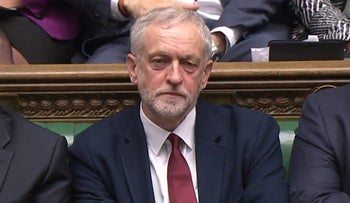 Labour party leader Jeremy Corbyn listening in parliament following a statement by British Prime Minister David Cameron, April 11, 2016.
